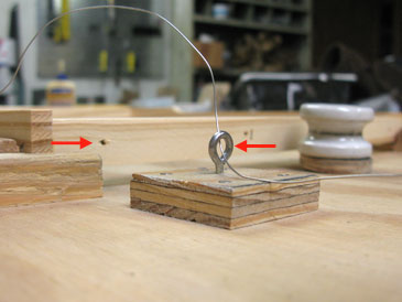 """in the frame  drill a 1/8"""" hole in the center of the washer, glue &  nail it, centered around the screw hole in the jig base, then attach the  spool"""